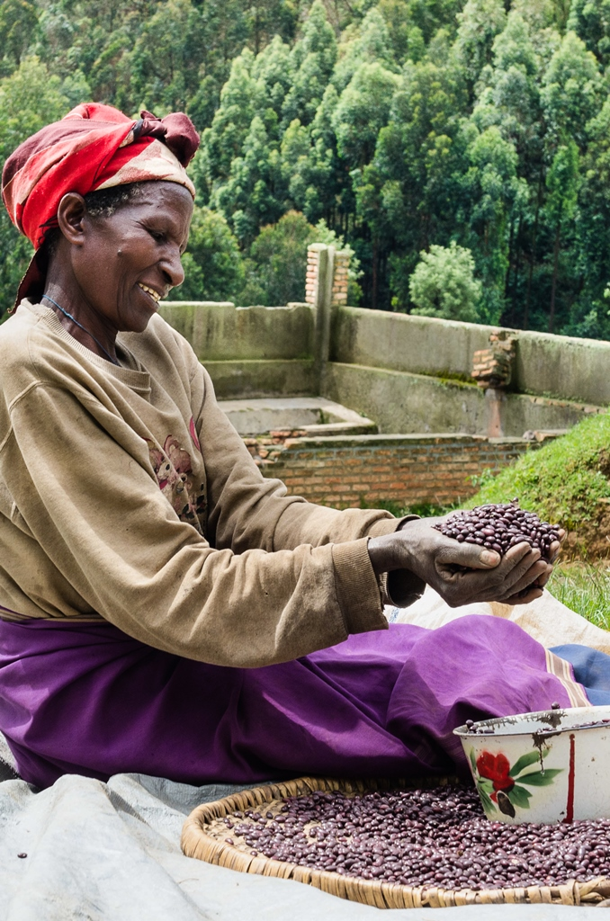 photo of woman holding iron beans